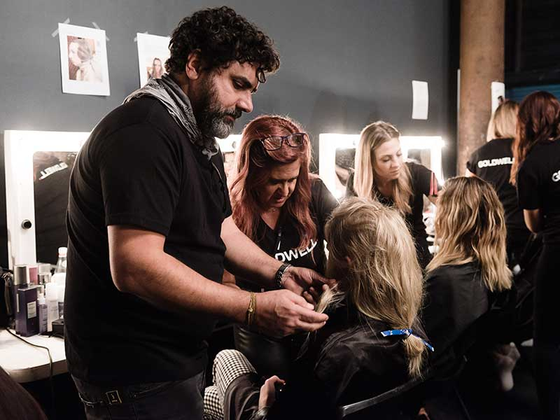 working hair backstage at Camilla Parade for Mercedes-Benz Fashion Week