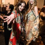 models having fun backstage at Mercedes-Benz Fashion Week Camilla, hair and makeup by Orbe